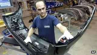 Worker at Germany's Magna car parts firm, 24 Apr 13