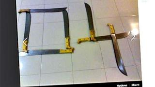 """Parang knives laid out to depict the gang symbol """"04"""""""
