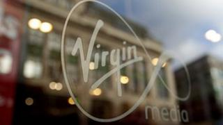 Virgin Media logo on a window