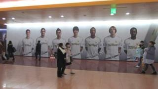 A giant poster of Swansea City players last season was displayed in a shopping centre in South Korea's capital city Seoul