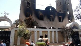 A picture taken on 14 August 2013, showing the facade of the Prince Tadros Coptic church after being torched by unknown assailants in the central Egyptian city of Minya