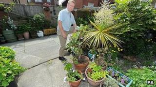 Mike Kelley with the award-winning blooms in Whitley Bay