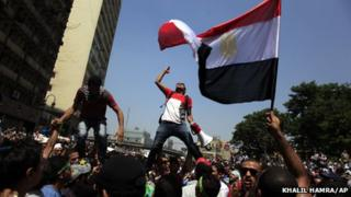 Muslim Brotherhood supporters with national flag in Cairo's Ramses Square (16 August 2013)