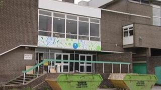 Stocksbridge Community Leisure Centre with skips outside