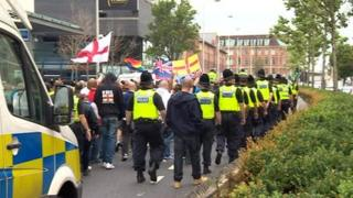 EDL supporters and police