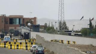 Security measures such as fences and roadblocks are seen around the compound of the British embassy in Sanaa
