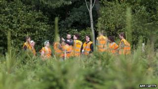 Legal observers gather at the site