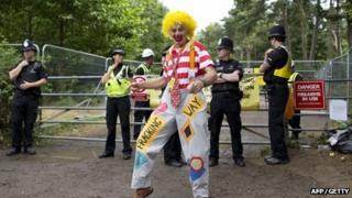 An activist dressed as a clown