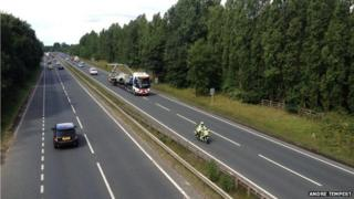 Plane on back of truck on dual carriageway
