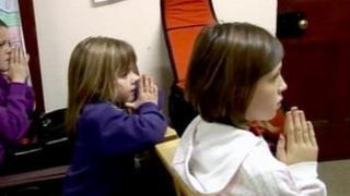 Girls praying in a church