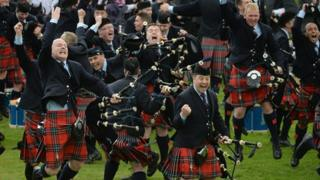 Field Marshall Montgomery band celebrate winning the 2013 World Pipe Band Championships for the third year in a row