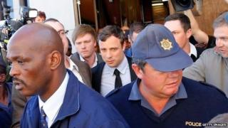South African athlete Oscar Pistorius leaves the Pretoria Magistrates Court after an indictment hearing on 19 August 2013 in Pretoria, South Africa
