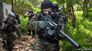 Indonesian airsoft enthusiasts show off their realistic weapons and equipment