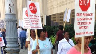 Pensioners picket outside the federal court in Detroit on 19 August 2013