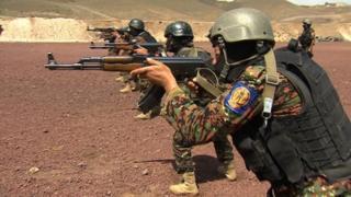 Yemen soldiers holding rifles on range, August 2013.