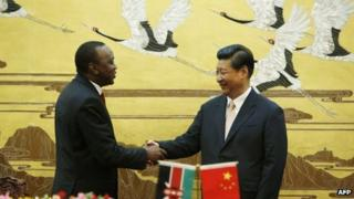 Kenya's President Uhuru Kenyatta and China's President Xi Jinping shake hands in Beijing on 19 August 2013