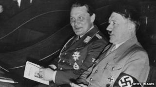 Hermann Goering (left) and Adolf Hitler (right)