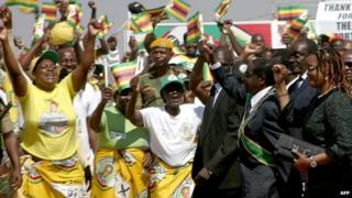 Zimbabwe President Robert Mugabe arrives for a speech at the National Heroes Acre in Harare on 12 August 2013