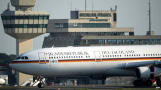 The plane transporting German Chancellor Angela Merkel from the G8 summit lands at the tarmac in Berlin (18 June 2013)