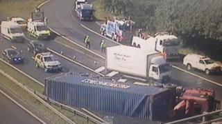 Overturned lorry on M8