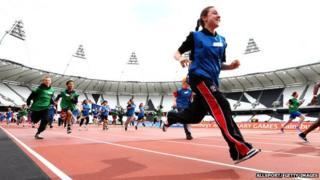 children running in Olympic stadium