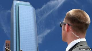 Image of an agent looking at a skyscraper