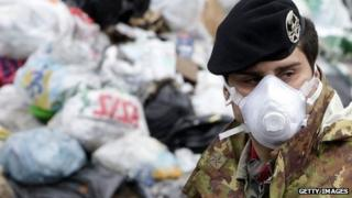 An Italian soldier collecting rubbish in Naples in 2010