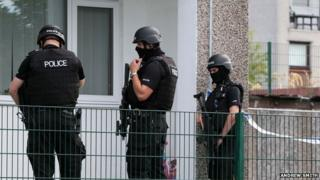 Armed police at the scene
