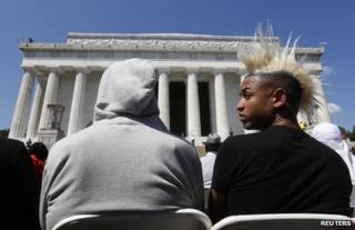Two young men attend the the 50th anniversary ceremony at the Lincoln Memorial in Washington, 24 August