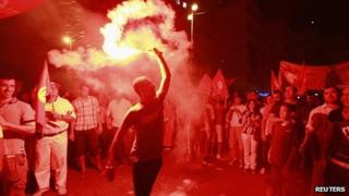 Anti-government protesters hold flares and shout slogans during demonstration in Tunis. 24 Aug 2013