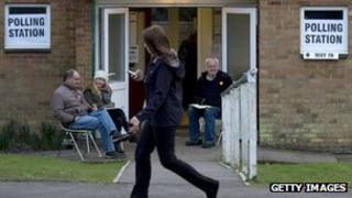 A woman passes a polling station