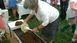 Mitzi Hayhurst with her giant pudding