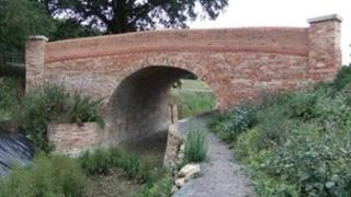A bridge over a refurbished section of canal