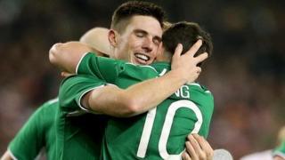 Republic of Ireland players Ciaran Clark and Shane Long celebrate