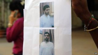 A poster with photos of Yasin Bhatkal