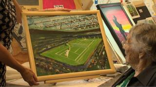 Dorothy Wheatley looks at her painting of Andy Murray