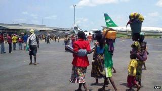 People on runway of Bangui international airport