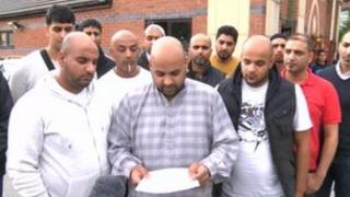 Mr Dim's family reading the statement