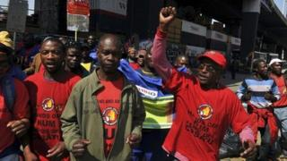 Members of the National Union of Mineworkers (NUM) take part in a strike in the central business district area of Johannesburg, August 27, 2013.