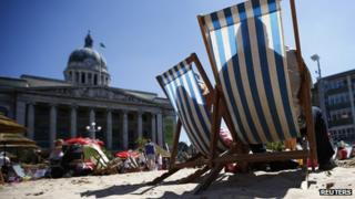 A couple rest in deck chairs on an urban beach during hot weather in Nottingham, central England, July 19, 2013