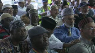 Ahmadis listen to a speech