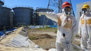 Japanese Economy, Trade and Industry Minister Toshimitsu Motegi (2nd R-red helmet) inspecting contamination water tanks