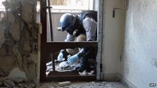United Nations (UN) arms expert collects samples in the Ghouta region