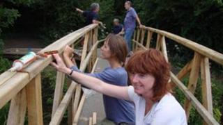 Volunteers building the new Cuttle Brook bridge