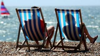 Sunbathers rest on Brighton beach