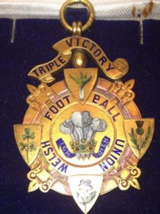 The Triple Crown winners' medal