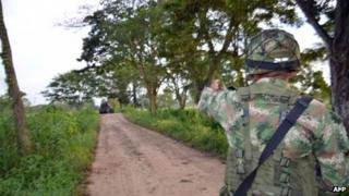 A soldier patrols near the town of Tame in Arauca on 25 August 2013