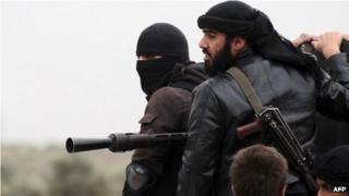 Members of the jihadist group, al-Nusra Front, in Aziza, Syria (4 April 2013)