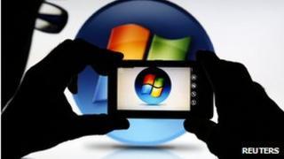 Nokia Lumia taking a picture of Windows logo