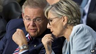 Senate Foreign Relations Chairman Sen. Robert Menendez, left, confers with committee member Sen. Barbara Boxer, on Capitol Hill in Washington, Tuesday, 3 September, 2013.